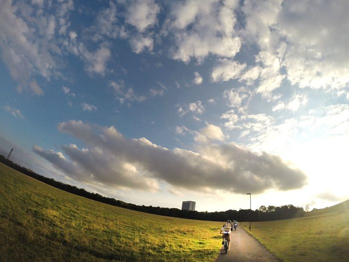 Newcastle Upon Tyne Cycling One Person Sky Landscape Cloud - Sky Nature Field Real People Beauty In Nature Grass
