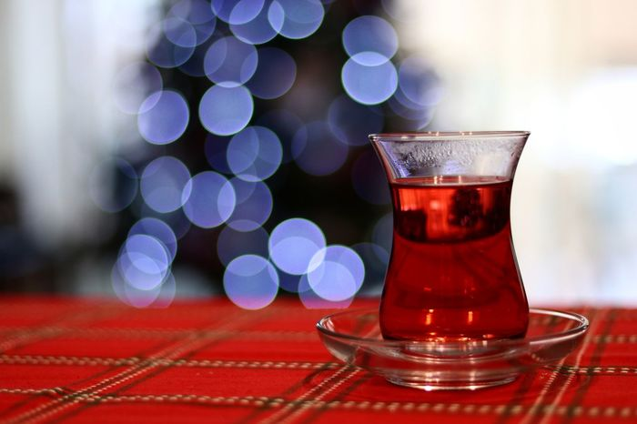 Tea Drinking Glass Red Red Tea Red Color Christmas Tree Christmas Decoration Christmas Lights MerryChristmas Family Family Time Cozy At Home Cozy Moments Blue Blue Color Blue Lights  Indoors  No People Glass Hot Hottea Red And Blue Close-up Freshness Defocused