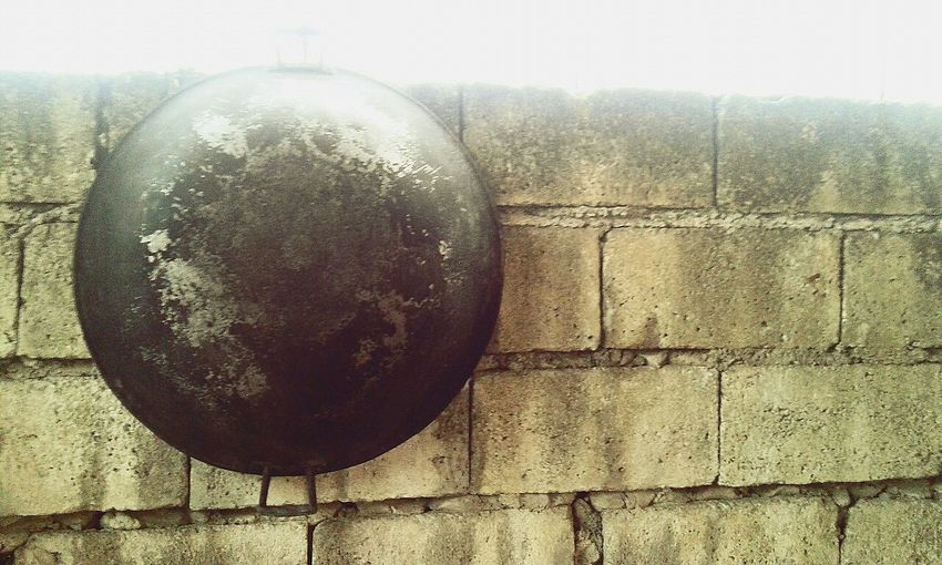Looks like a hanging moon on the brick wall Oldtime Hanging On The Wall Cooking Utensil Moon Surface