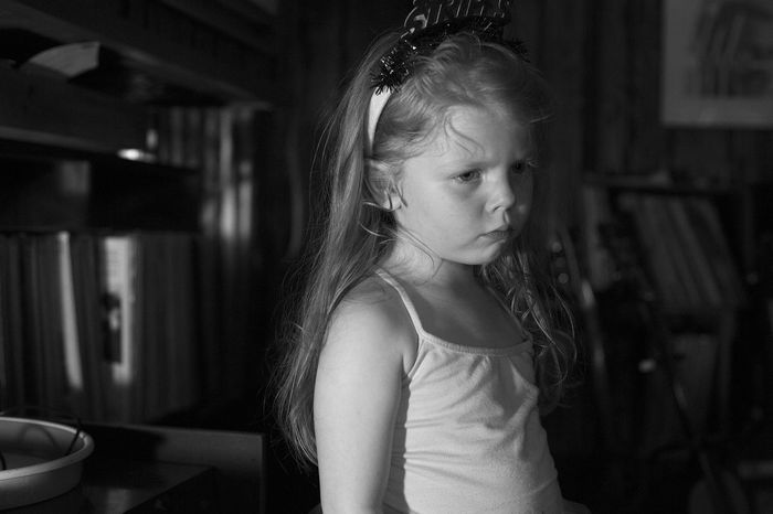 A young girl looks with sadness. Angry Black And White Child Childhood Children Only Close-up Depressed Elementary Age Focus On Foreground Girls Home Interior Indoors  Mad One Girl Only One Person Real People Sad Sadness Serious