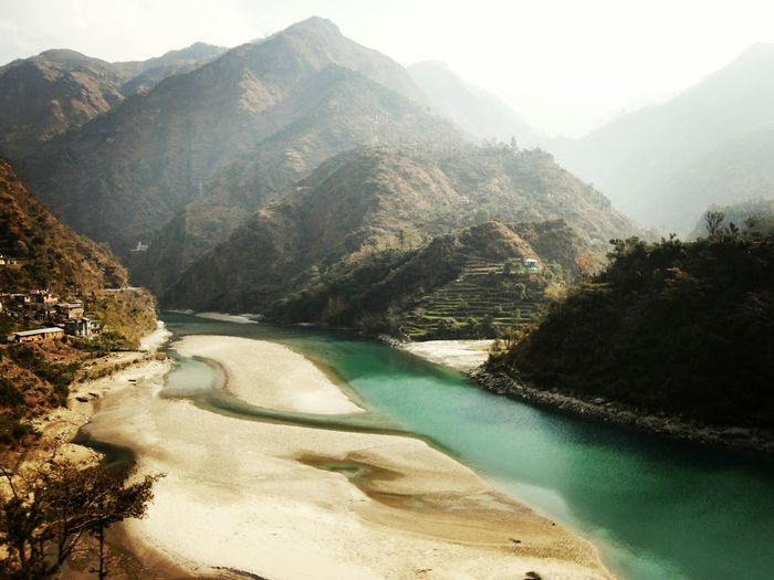 Beas River Flowing Amidst Mountains In Foggy Weather