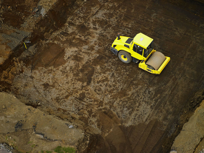 High angle view of yellow toy car on rock