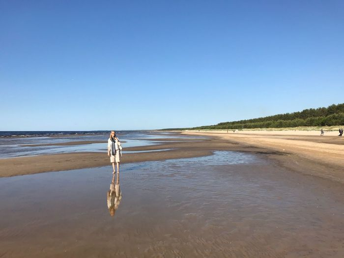 Alone on the beach Tranquility Blue Horizon Over Water One Person Scenics - Nature