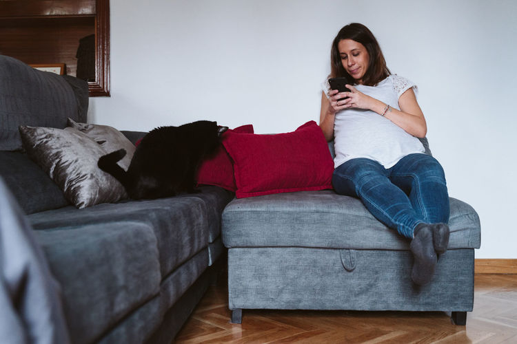 Pregnant woman spending leisure time at home