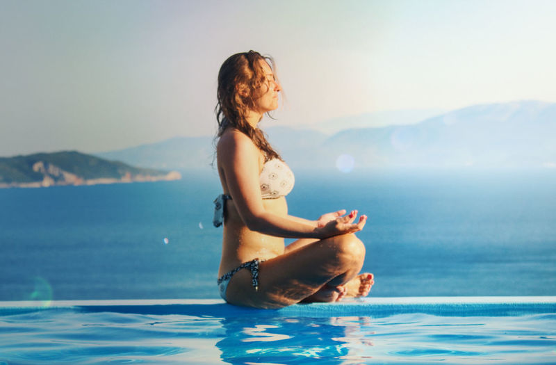 Godiscoversummer Yoga Beautiful Woman Beauty In Nature Day Focus On Foreground Full Length Happiness Horizon Over Water Lefkada Leisure Activity Lifestyles Mountain Nature One Person Outdoors Real People Scenics Sea Sitting Sky Water Young Adult Young Women Summer Exploratorium
