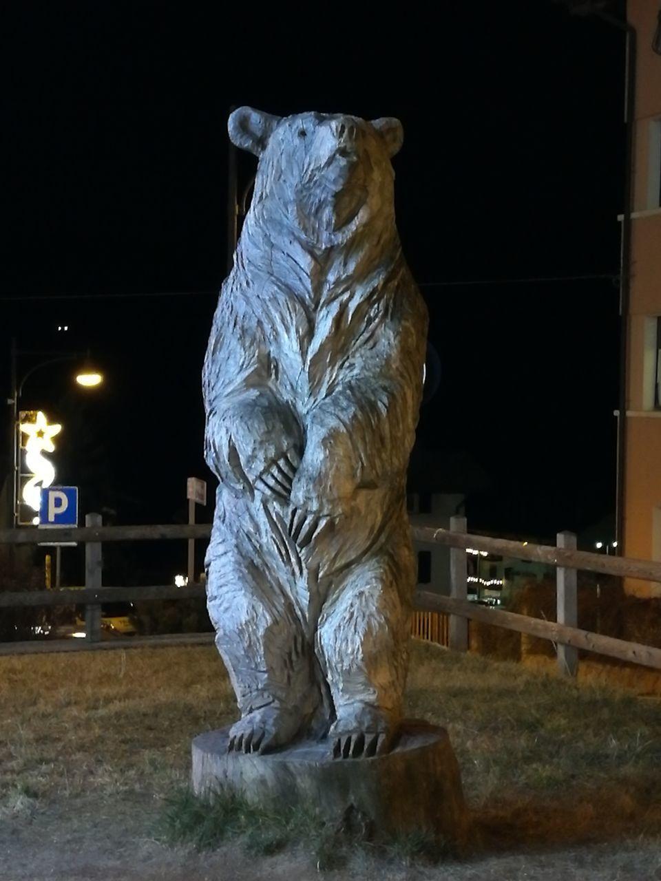 night, illuminated, sculpture, statue, no people, outdoors, black background, animal themes, close-up, mammal