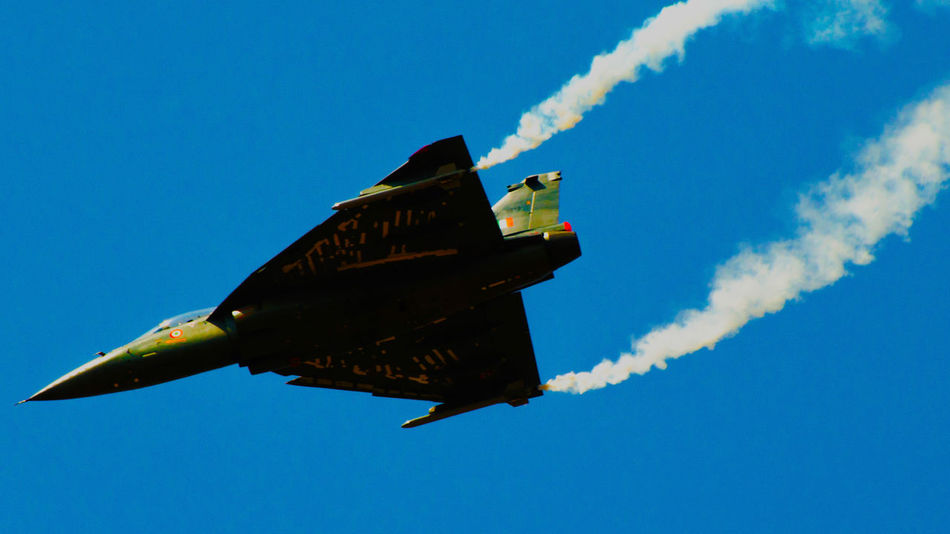HAL Tejas India HAL Tejas IAF Smoke - Physical Structure No People Fighter Plane Speed Airshow Flying Clear Sky Air Vehicle Day Transportation Blue Airplane Low Angle View Vapor Trail Mid-air Outdoors Sky Aerobatics Motion Military Airplane Nature