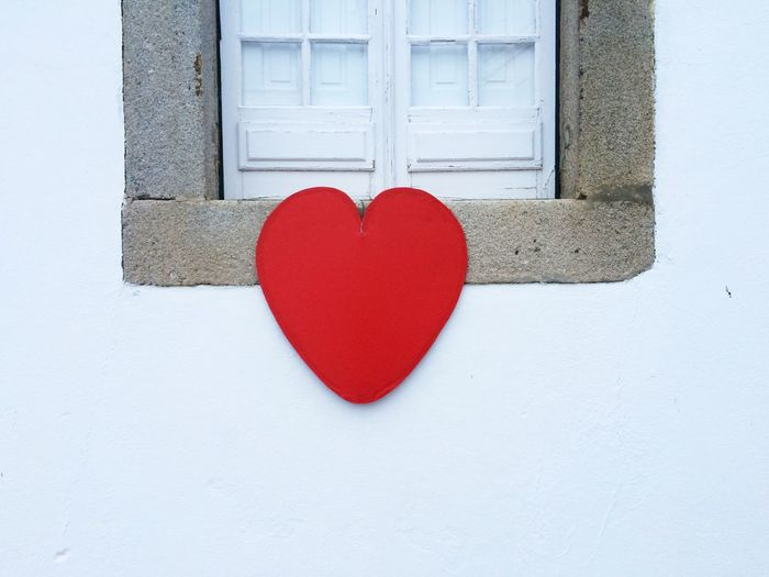 Close-up of heart shaped paper on wall