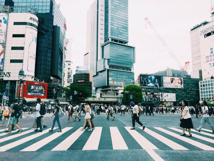 Crowd Crossing Road Intersection At Shibuya