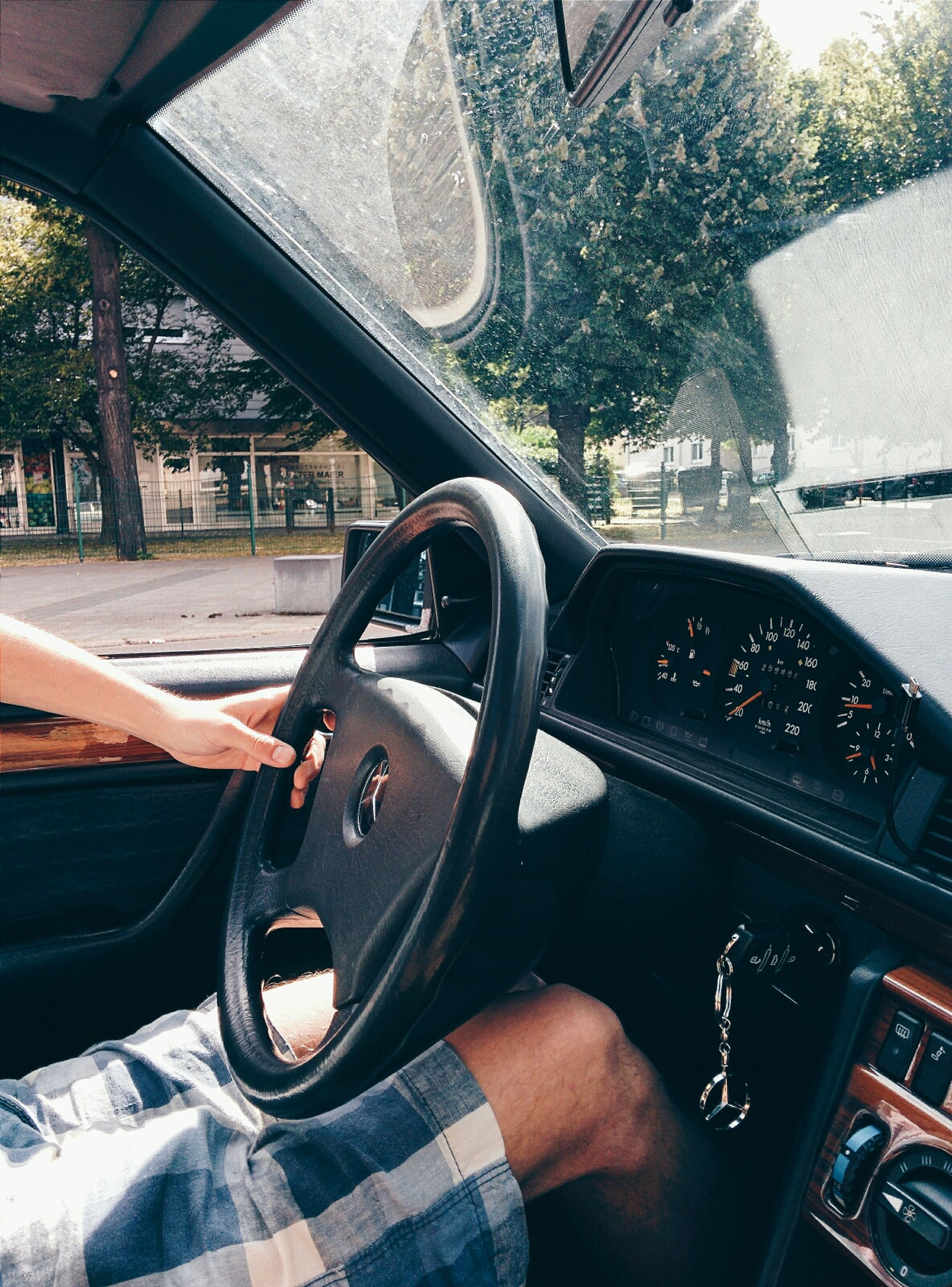 transportation, land vehicle, mode of transport, car, part of, tree, lifestyles, low section, car interior, travel, road, personal perspective, street, bicycle, cropped, vehicle interior, leisure activity