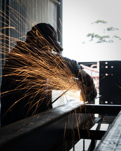 Blurred Motion Focus On Foreground Indoors  Long Exposure Men Metal Metal Industry Occupation One Person Real People Skill  Sparks Welder Welding Working