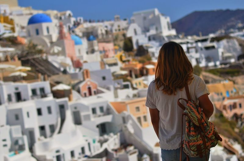 Rear view of woman standing against santorini