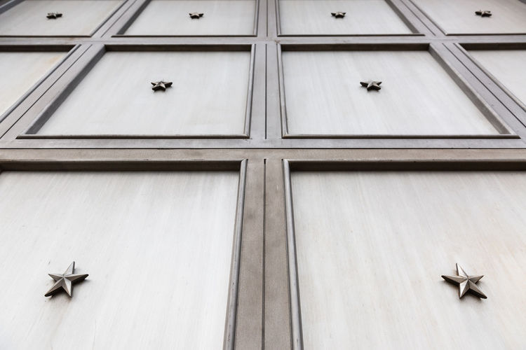 The best garage door that Washington, DC has to 's behind it? Garage Door Patriotic, Patriot, Flag, American Flag, Honor, Respect Wall Close-up Door Garage Low Angle View Metal Metal - Material Pattern Star Shape Stars Texture Wall - Building Feature