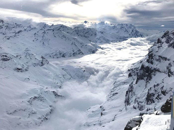 Clouds seem like flowing water Beauty In Nature Scenics - Nature Cold Temperature Winter Mountain Snow Tranquility Snowcapped Mountain Environment Tranquil Scene Cloud - Sky Landscape Day Nature Mountain Range Sky Non-urban Scene White Color Idyllic No People