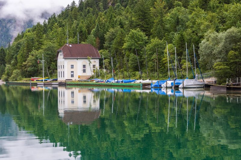 Beauty In Nature Tree Water Reflection Lake Nautical Vessel Nature Waterfront Outdoors Beauty In Nature german Sky mountain