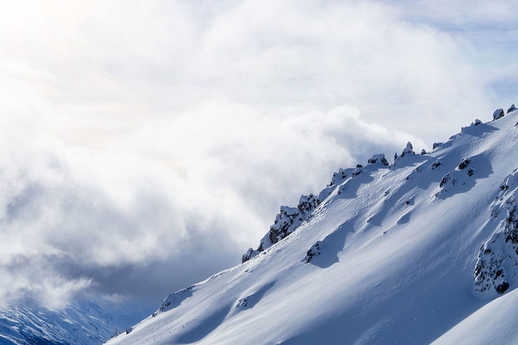 Winter panorama in graubünden Beauty In Nature Cloud - Sky Cold Temperature Copyspace Frozen Mountain Mountain Range Nature Scenics Season  Snow Snowcapped Mountain Weather White Color Winter
