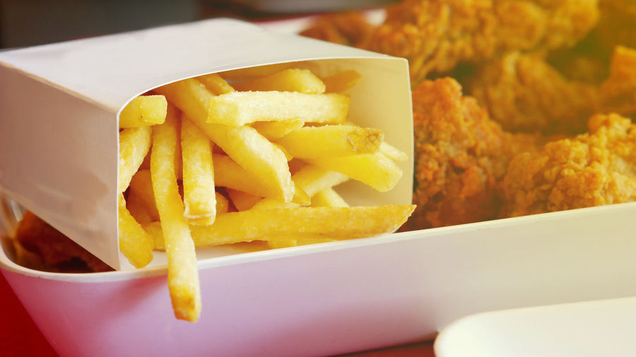 Potato Indoors  Freshness Close-up Still Life No People Focus On Foreground Fast Food French Fries Yellow Table Ready-to-eat Snack Deep Fried  Unhealthy Eating Food Prepared Potato Fried Take Out Food Comfort Food Temptation French Fries Fast Food Food And Drink