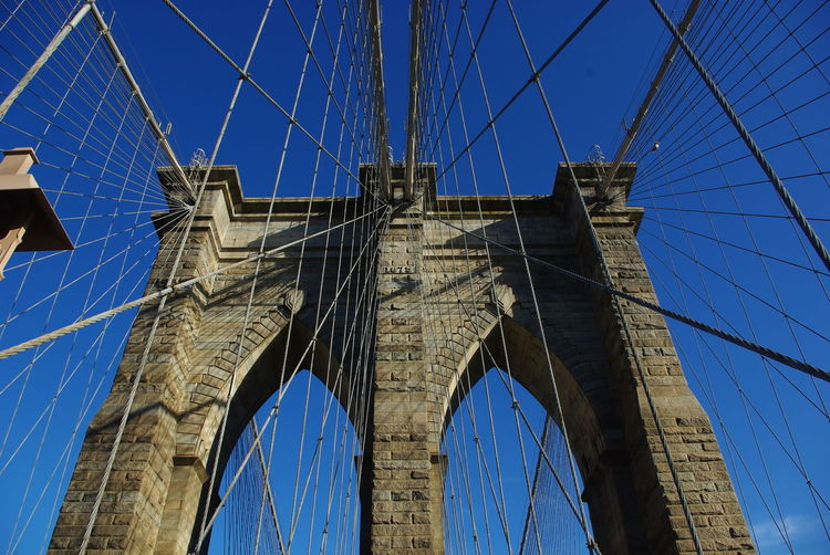 Photos of New York City, United States 2011 Architecture Bridge - Man Made Structure Brooklyn Brooklyn Bridge / New York Built Structure Cable Clear Sky Connection Day Engineering Low Angle View No People Outdoors Sky Steel Cable Suspension Bridge Tourism Transportation Travel Travel Destinations