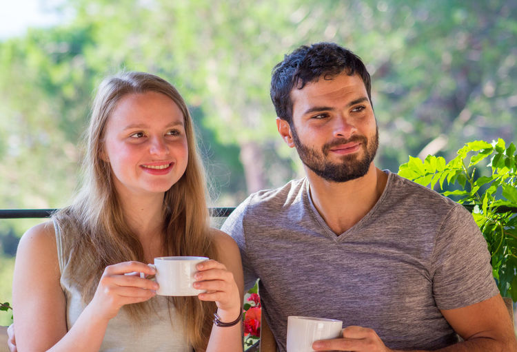 Young Couple Looking Away While Having Coffee
