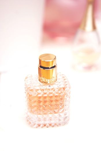 Perfume fragrance colognne bottle. Cosmetics, beauty and body care concept. Vertical image. Parfume Parfume Bottle Parfumerie Perfume Sprayer Perfumes Perfume Lover Perfume Lover Perfumeaddict Parfumerie Parfumerose Liquid Cologne Pink Elegant Cosmetics Body Care Crystal Aromatic Aroma Female Perfume Perfume Sprayer Beauty Body Care White Background Females Beauty Product Bottle Close-up Aromatherapy