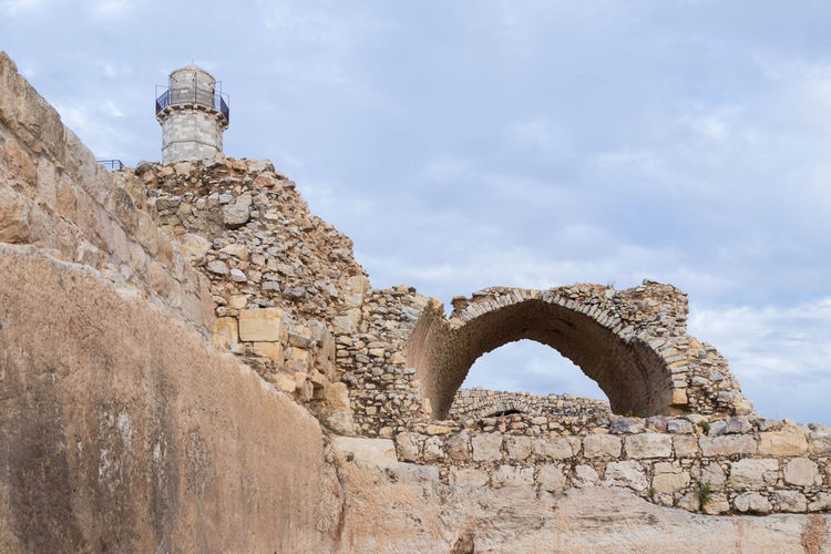 Low angle view of old ruins against sky