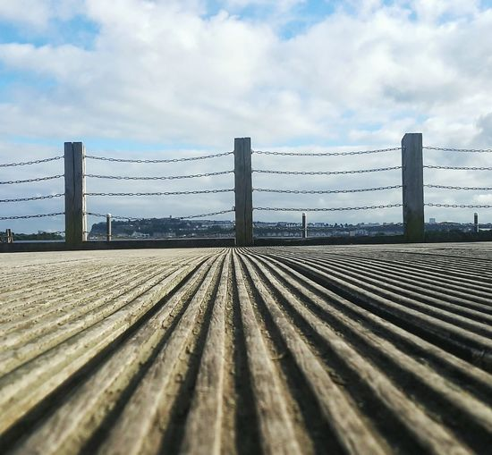 Mobile Photography Lines Low Angle View Eye4photography  Chainlink Fence Cardiff Cardiff Bay United Kingdom Blue Sky No People Sky From My Point Of View Clouds Clouds And Sky Close-up Taking Photos Taking Pictures Mobilephotography Samsungphotography Chain Fence Blue Focus On Foreground Backgrounds LINE