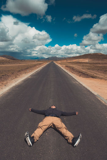 Long way Holiday Road Trip Long Way To Go... Tibet Human Arm Adult Front View Transportation Lying Down Men The Way Forward Direction Land Leisure Activity Day Real People Lifestyles Sunlight Nature Full Length Road Sky Cloud - Sky One Person EyeEm Selects