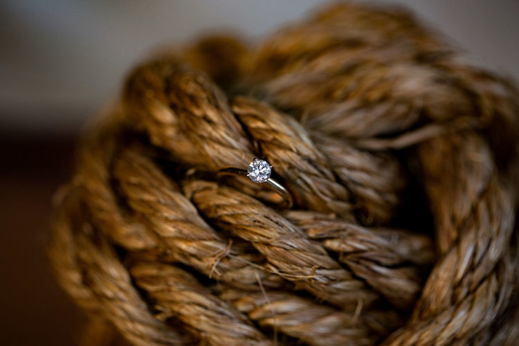 Close-Up Of Diamond Ring In Rope