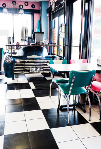American 1950s Style Diner 1950s 1950sstyle American Classic Food And Drink Mid-Tennessee Milkshake Nolensville United States Chair Chairs Close-up Day Deep South Diner Food Indoors  No People Pink Color Restaurant Seating Tennessee Turquoise Color Vinyl Records