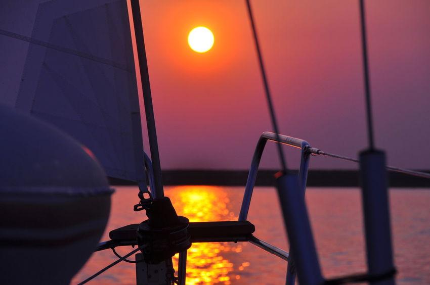 sundowner under sails Illuminated Nautical Vessel No People Orange Color Outdoors Sailboat In Sunset Sky Sun Sunset Water Purple Sunlight Sunset_collection