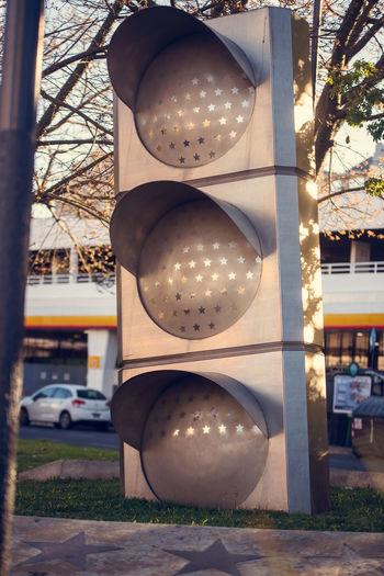 Illuminated street light by road in city
