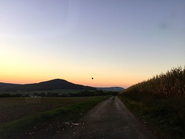 Sunset The Way Forward Nature Road No People Tranquil Scene Scenics Beauty In Nature Landscape Tranquility Outdoors Clear Sky Sky Transportation Grass Day