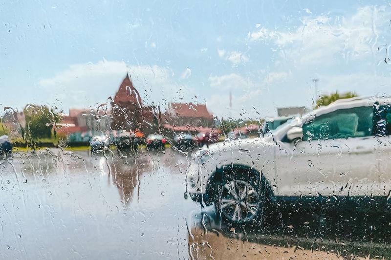 Cars on wet glass window during rainy season