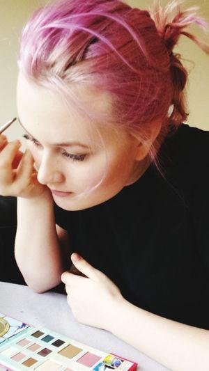 Young Woman Applying Make-Up At Home
