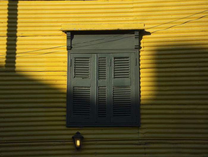 Buenos Aires Buenos Aires 💙 Buenos Aires, Argentina  Travel Photography Architecture Boca Boca, Buenos Aires Colour Coloured Window Shadow Shutter Shuttered Windows Tourism Travel Destinations Window Window Shutters Yellow
