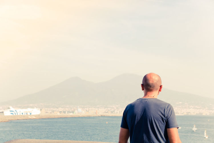 Naples Italy❤️ South Italy City Rear View One Person Water Real People Lifestyles Beauty In Nature Nature Men Mountain Sky Scenics - Nature Day Waist Up Leisure Activity Sea Standing Land Copy Space Looking At View Outdoors Volcano Vesuvio Looking Vesuvio Da Napoli Mediterranean  Mediterranean Sea