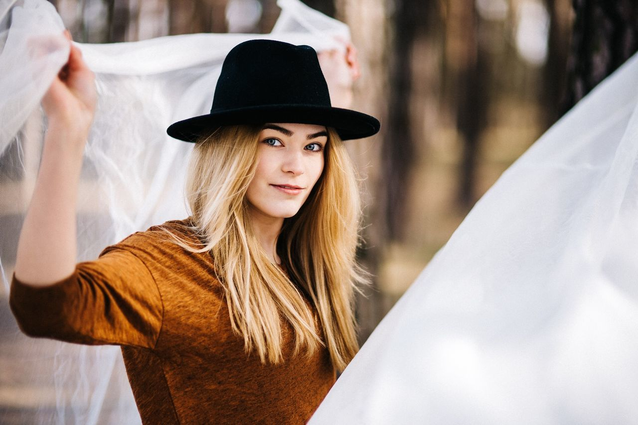 hat, young women, young adult, real people, portrait, lifestyles, casual clothing, one person, beautiful woman, fashion, leisure activity, looking at camera, women, outdoors, fashion model, day, close-up