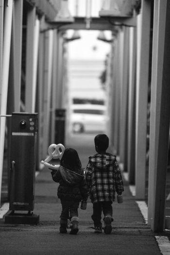 Children Walking In Street