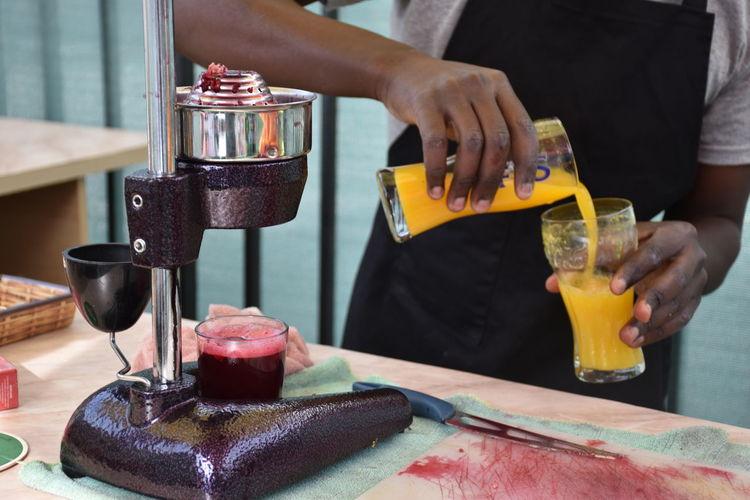 Midsection of man preparing juice