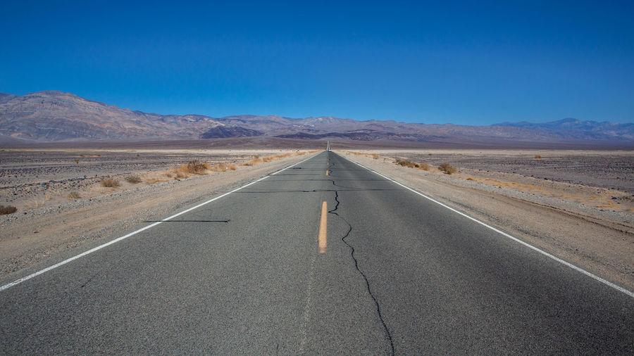 View of road at desert against sky