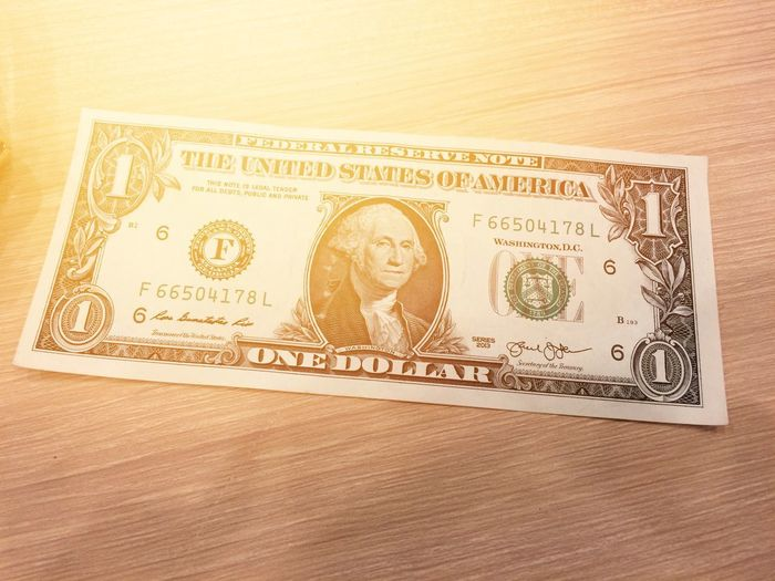 US dollar for use in everyday life United States Wachington D.C New York Set Market Business Sale Wood Using People Richness Cash Pay Buy One Dollar  US Dollar Dollar Money Paper Currency Currency Finance Wealth No People Gold Colored Close-up Day