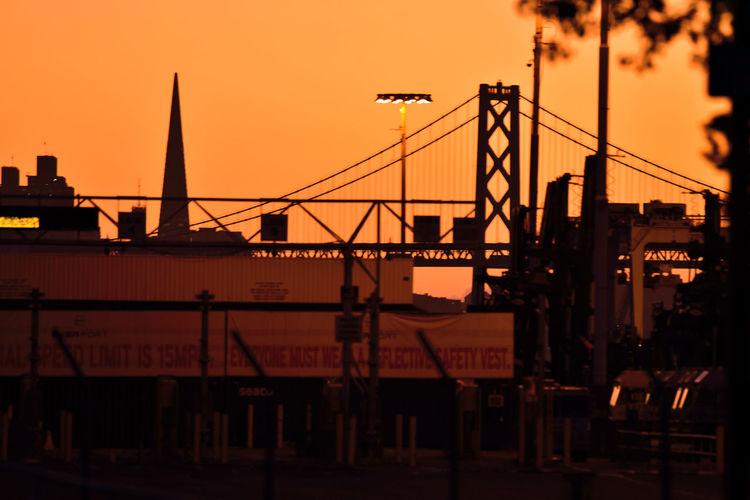 Silhouette of bridge against sky during sunset