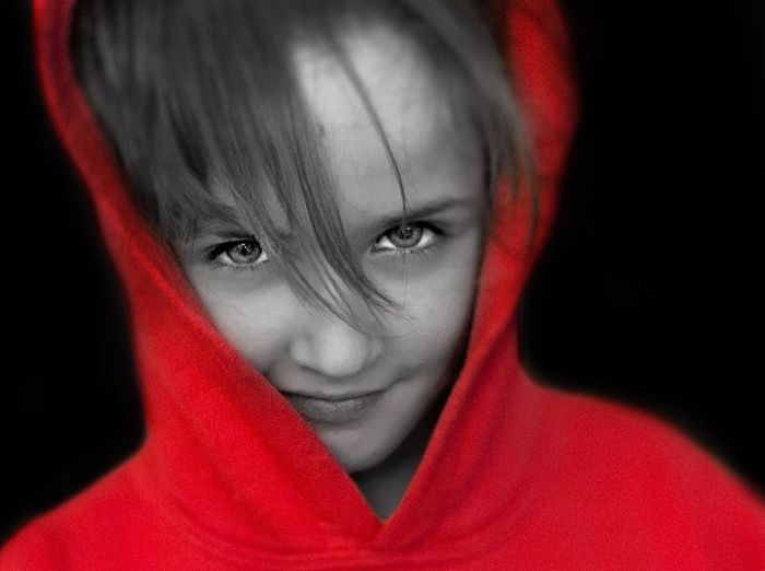 Mollie messing around IPhoneography ShotOnIphone Portrait Headshot One Person Red Child Looking At Camera Childhood Human Face Offspring Close-up Indoors  Human Body Part Black Background Front View Hood - Clothing Lifestyles Innocence Real People