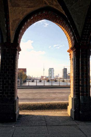 Distant View Of Fernsehturm Tower Seen Through Oberbaum Bridge Arch