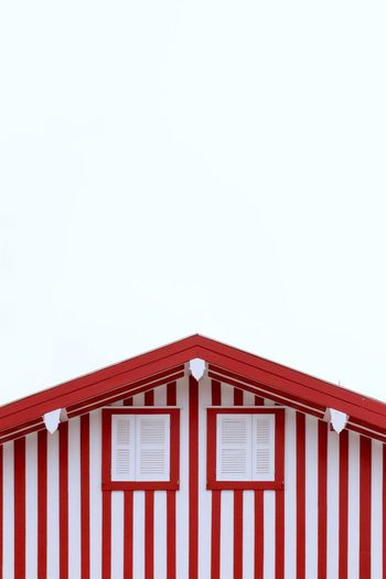 These red stripes, the most colorful houses in Portugal. Eye4photography  Minimalism Eyeemphotography EyeEm Gallery EyeEmNewHere Aveiro Portugal Copy Space Building Exterior Built Structure Architecture Clear Sky Building House Sky Red White Color Roof Wall - Building Feature Outdoors Cottage