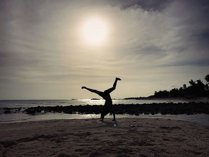 Living life Beach Vacation Sunset Cartwheel Fun Silhouette Silouette & Sky Sky Leisure Activity Outdoors Life Happiness Light And Shadow Travel Vacations PhonePhotography EyeEm Best Shots EyeEm Best Edits EyeEm Nature Lover EyeEm Gallery EyeEm EyeEmBestPics Wanderlust Adventure