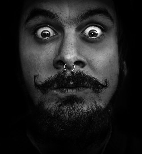 Argentina Body Piercing Rock Portrait Looking At Camera One Person Facial Hair Front View Headshot Indoors  Beard Close-up Serious Black Background Young Adult Human Face Real People Body Part Human Body Part Adult Men Mustache Dark Contemplation Human Hair