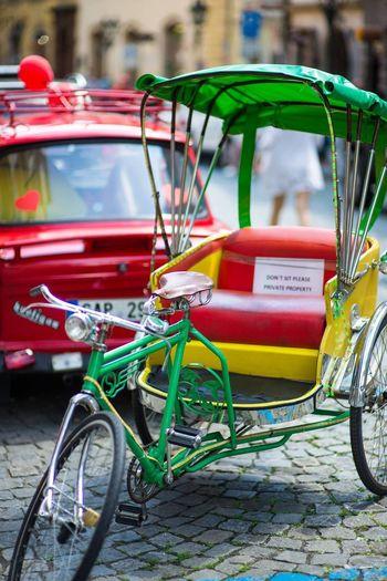 Bicycle Rickshaw Parked On Cobblestone