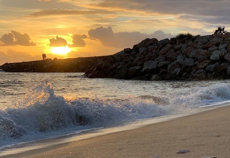 Sunset waves Sunset Sky Water Beauty In Nature Sea Scenics - Nature Cloud - Sky Beach