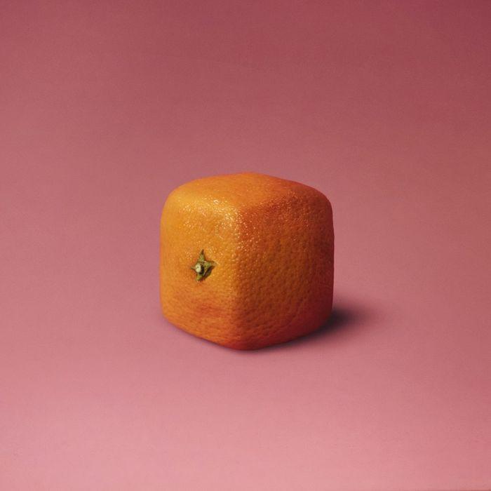 Close-up of square orange against pink background